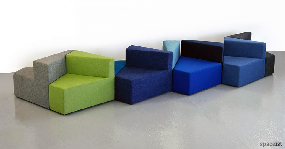 Long line of looby seating in green, blues and blacks
