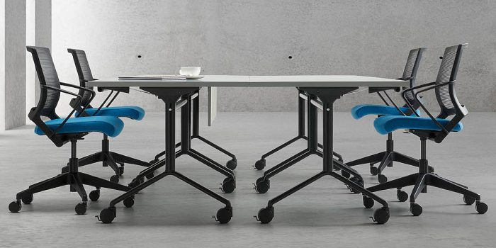 Black folding table with a white top