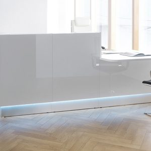 Glass Reception Desk on Wood Floor