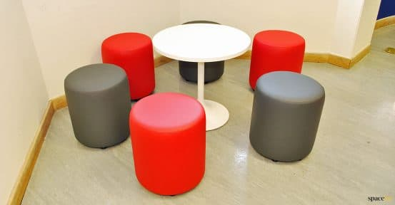 Low padded stools for common room