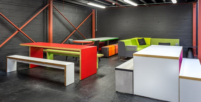 Spaceist showroom red canteen tables