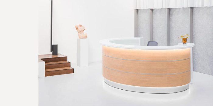 Oval reception desk in oak wood