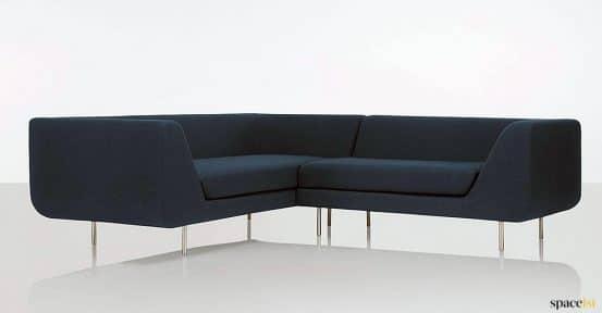 Dark blue four seater corner sofa