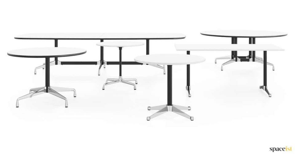 Group of oval and round white meeting tables