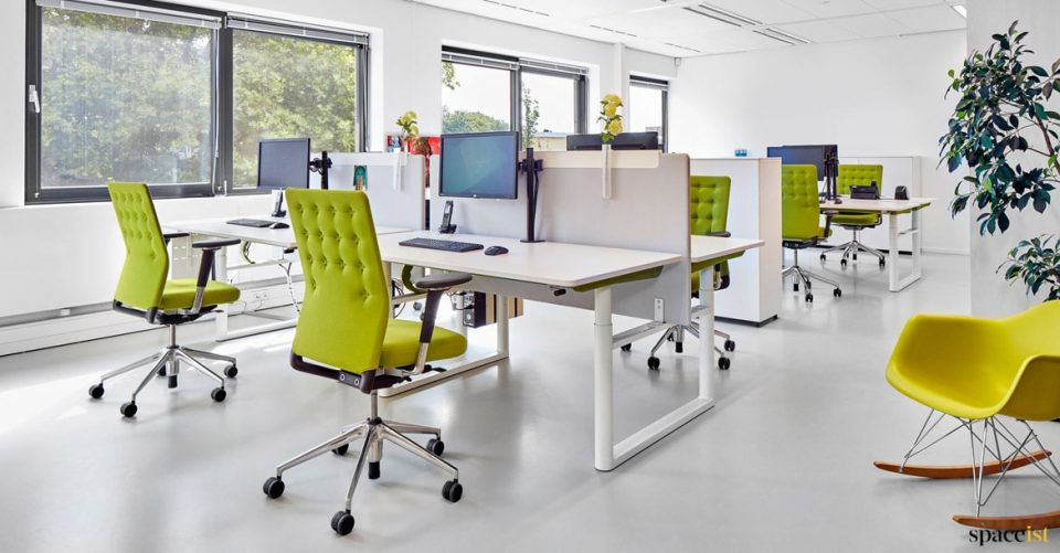 Office with green buttoned desk chairs