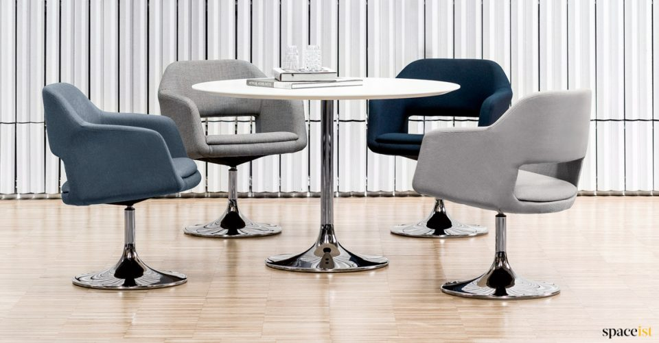 Four tub style chairs around a round table