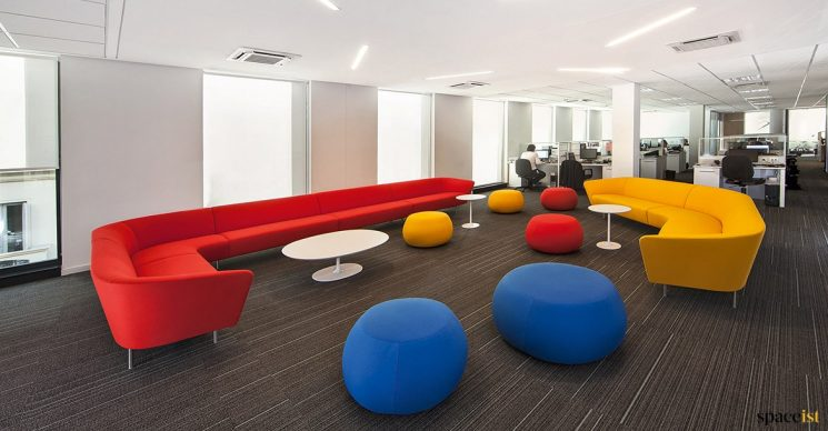 Large red sofa in modern office
