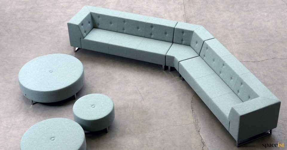 Angles sofa with large round stools