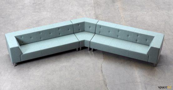 Angled sofa green