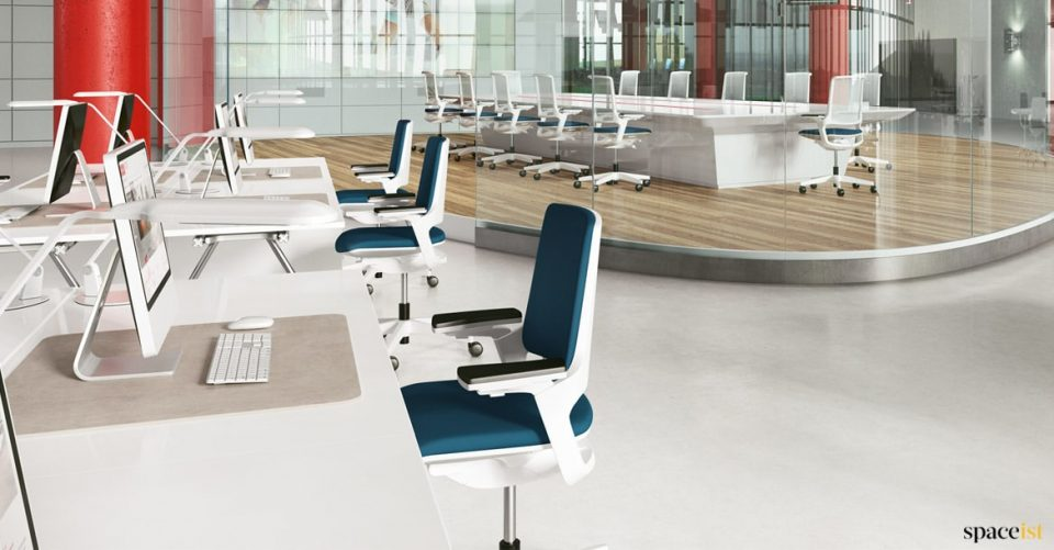 Office with blue desk chairs