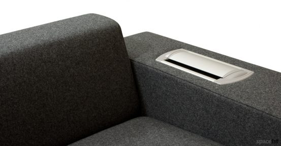 Dark grey office sofa with plug socket in arm