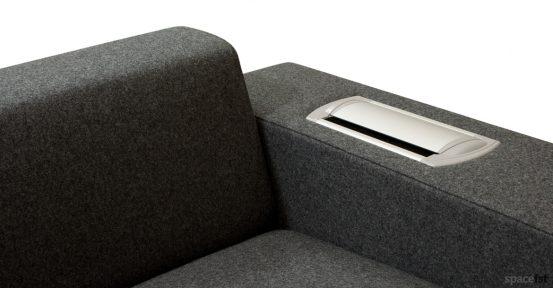 Dark grey office sofa with plug socket in arm