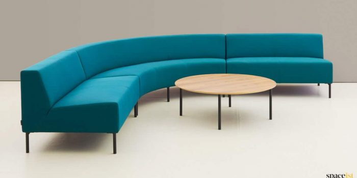 Blue corner sofa with curved seat
