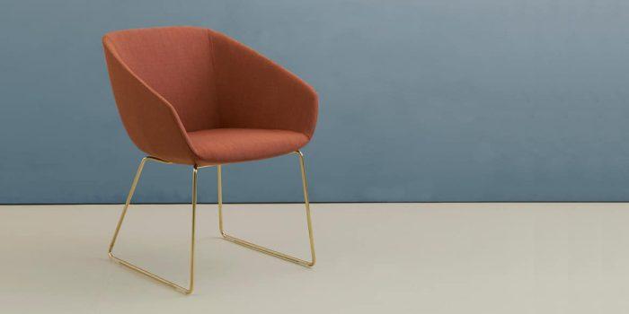 Tub chair with a brass leg