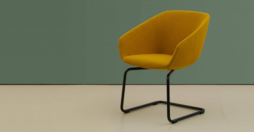 Yellow chair in retro fabric