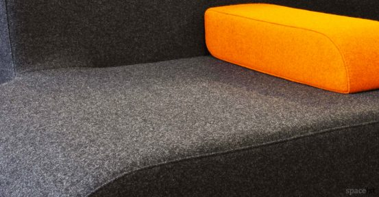 30 curvy orange reception sofa close-up