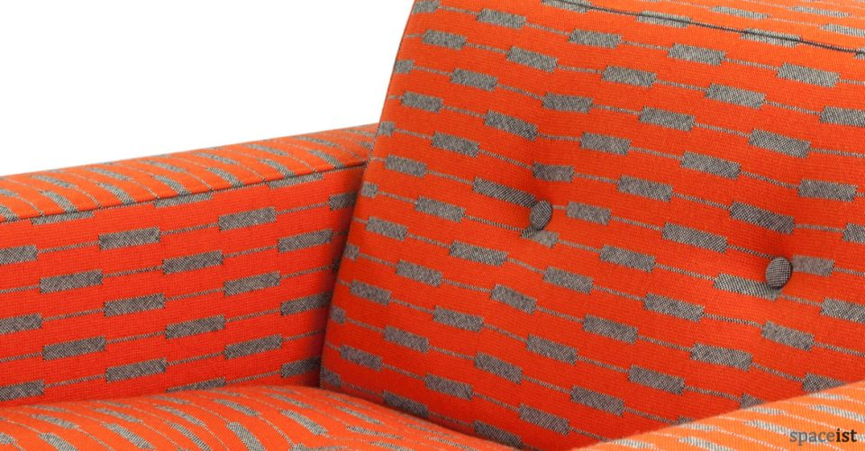 46 sofa close-up in orange paterned fabric