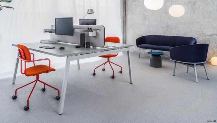 Grey desk orange chairs