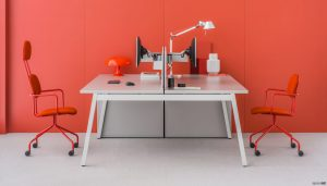 Grey desk orange wall