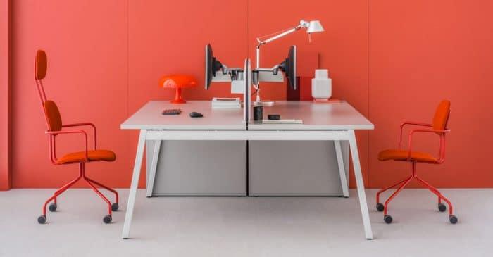 Grey desk orange wall