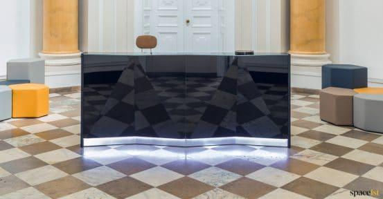 Black glass reception desk