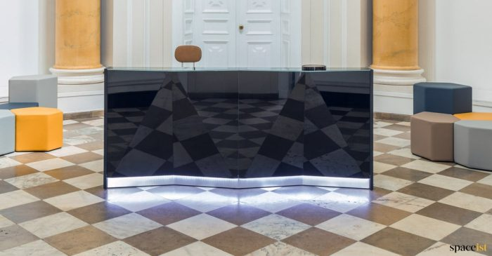 Black glass reception desk