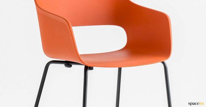 Orange + black tub chair closeup