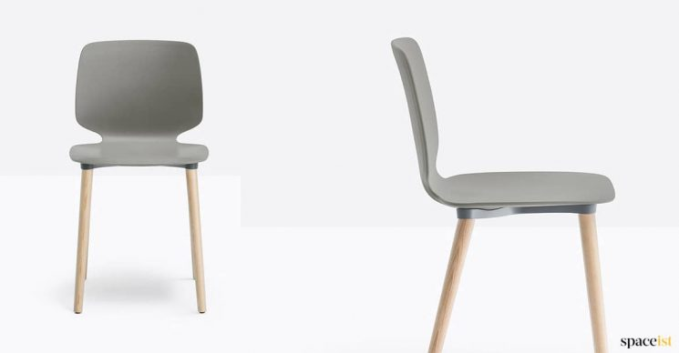 Grey plastic chair with a wood leg