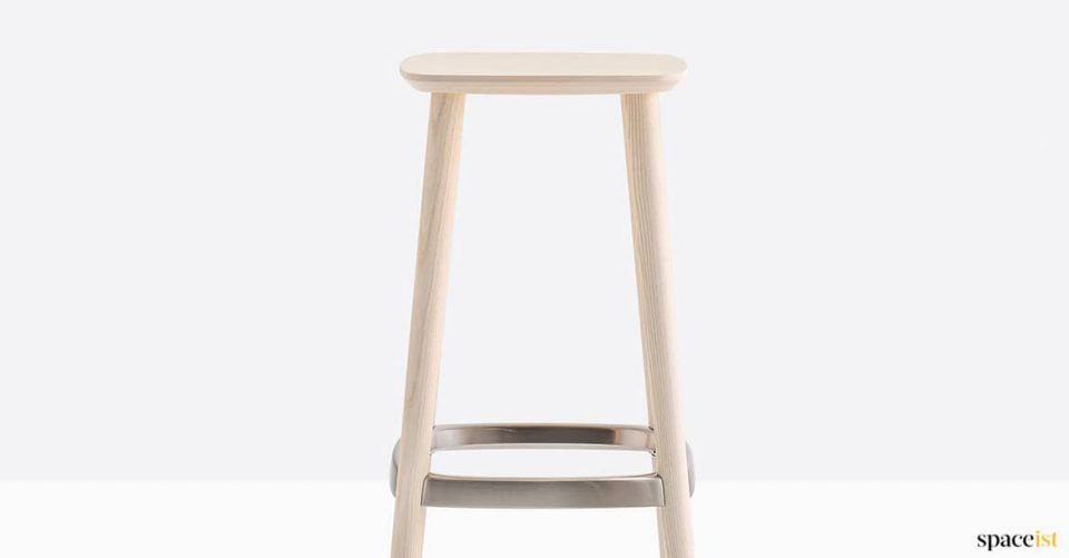 Wood stool with brass foot rest