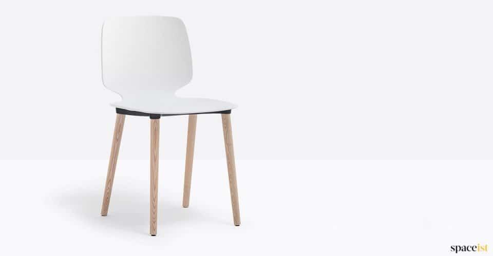 White chair wood leg