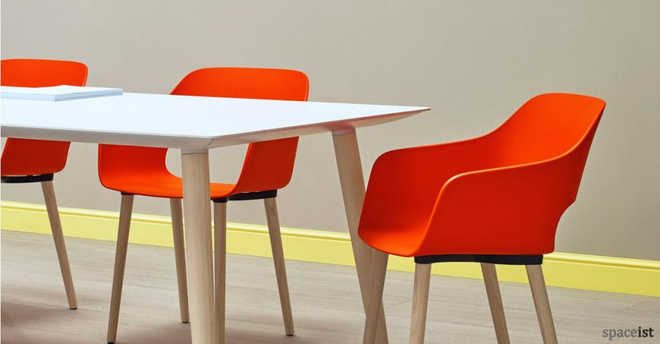 Babila white wood meeting table with orange chairs