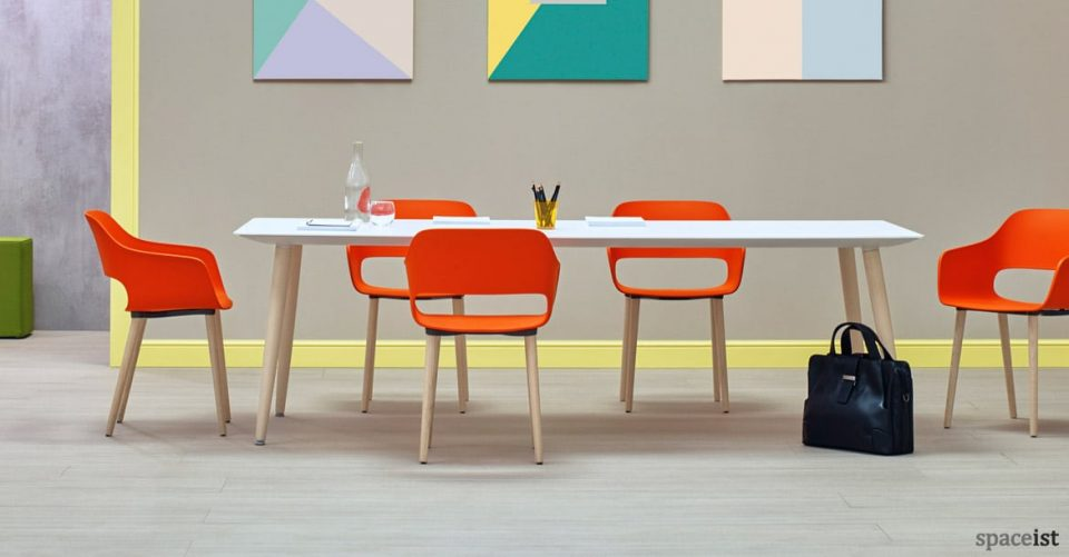 Babila white meeting table with orange meeting chairs