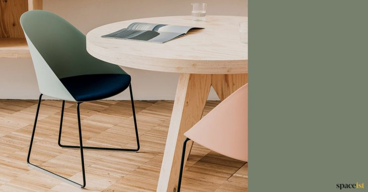 Sage green chair with plywood table