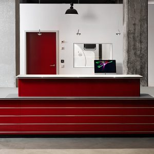 Large red reception desk