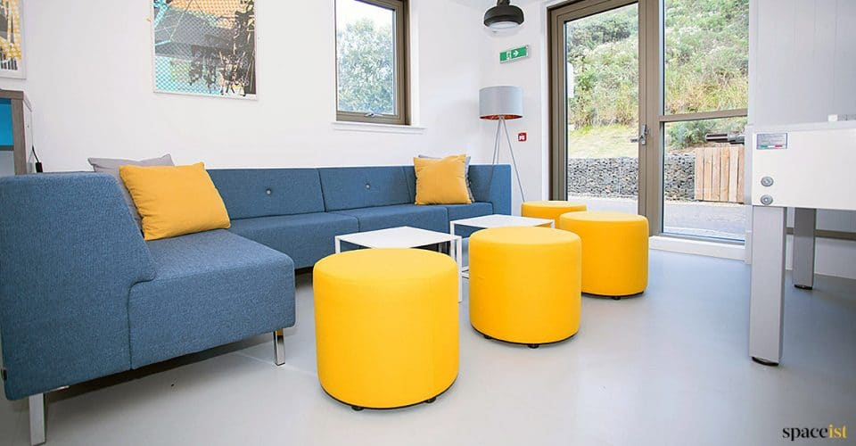 Blue corner sofa for common room