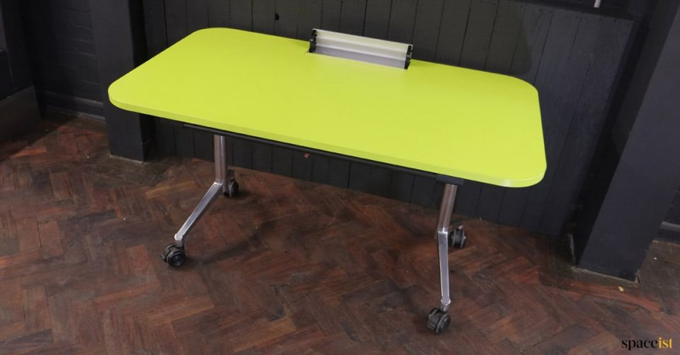 Green table with cable hatch sockets