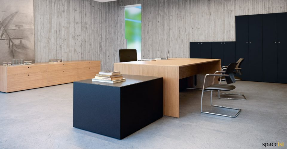 Office with large oak desk + black storage