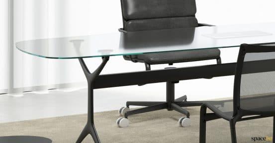 Glass + black executive desk closeup