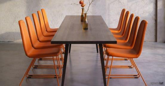 High back meeting chair in orange vinyl