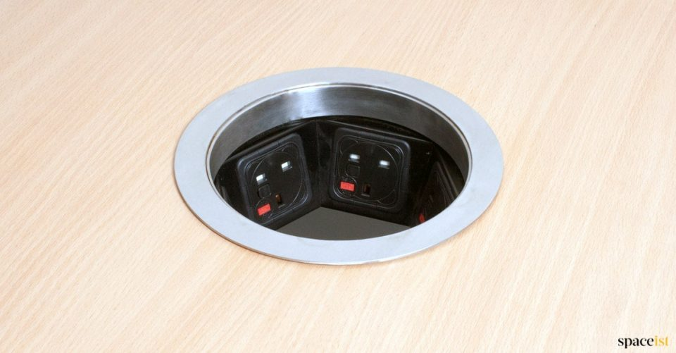 Large round grommet with plug sockets