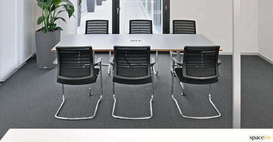 six person table with mesh chairs