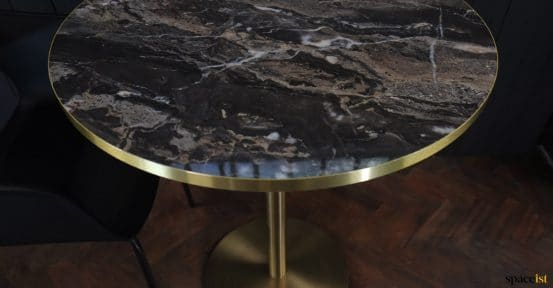 Marble + brass table close-up
