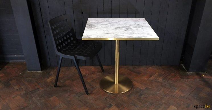 White marble table brass