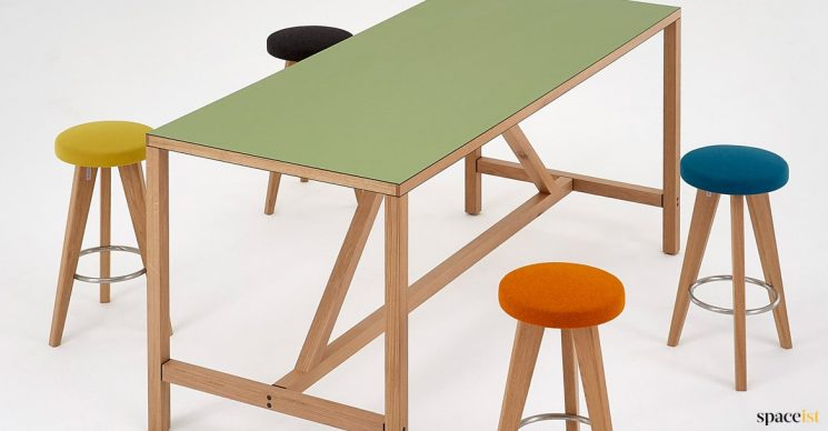 Green modern table with wood supports
