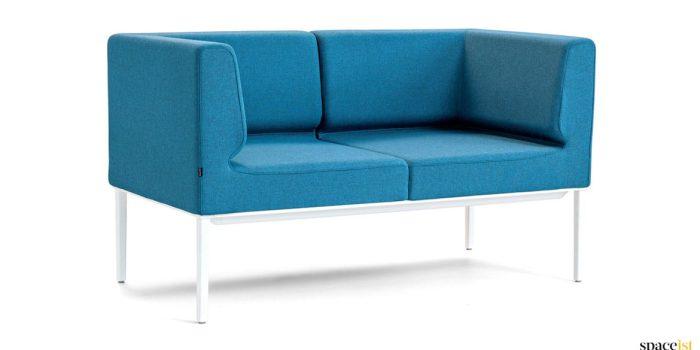 Small bright blue + white sofa