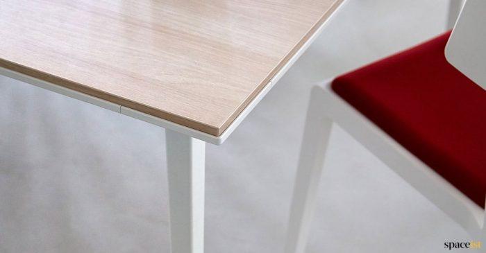 White + wood office desk closeup