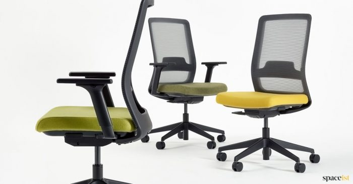 Max task chair with a green + yellow seat