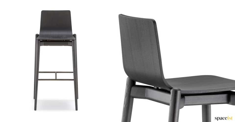 Black bar stool with a solid wood frame
