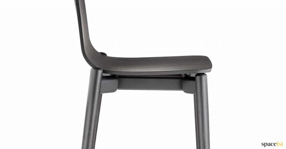 Black bar stool with a solid ash frame + plywood seat