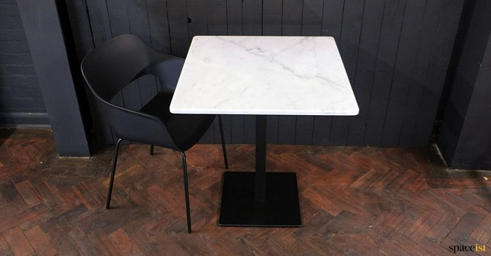 White marble top with black chair